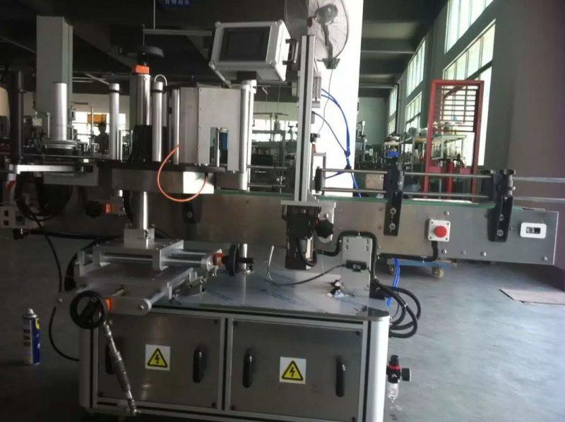 China Suc de fructe / legume Mașină de etichetare a autocolantului pentru sticlă rotundă pentru industria băuturilor furnizor